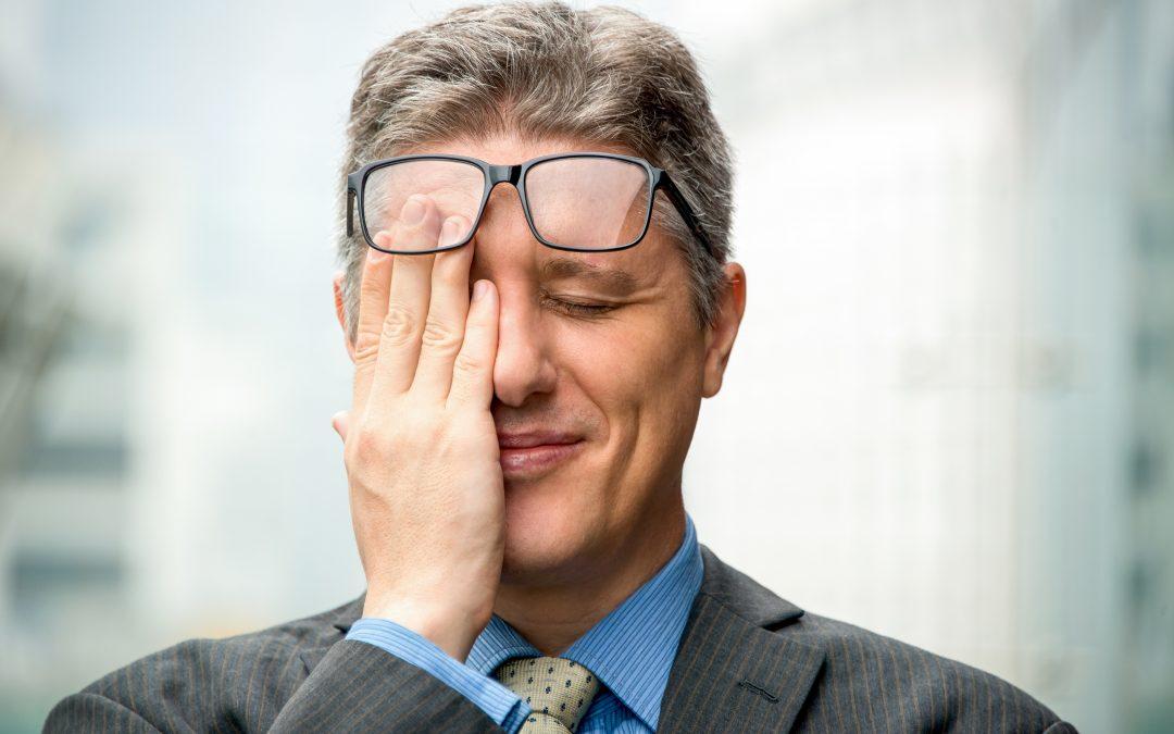 Closeup of Smiling Embarrassed Business Man